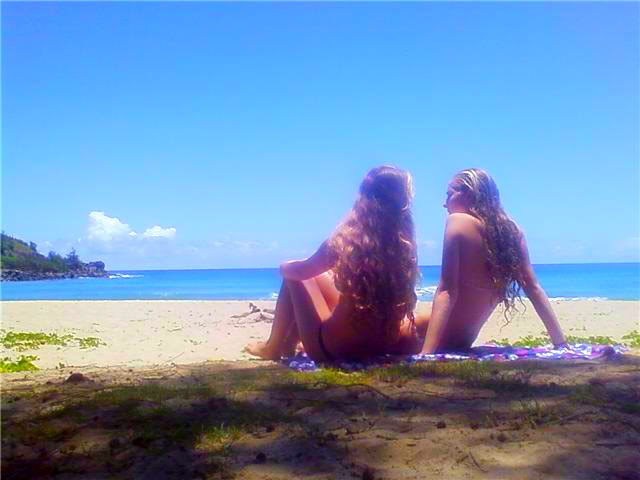 Girls relaxing on a gorgeous Kauai beach