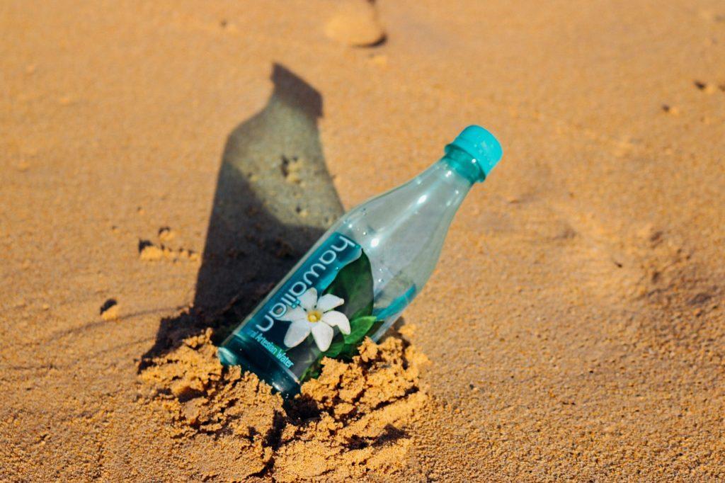 Hawaiian bottle in the sand