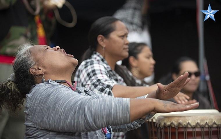 Native Hawaiian playing Pahu