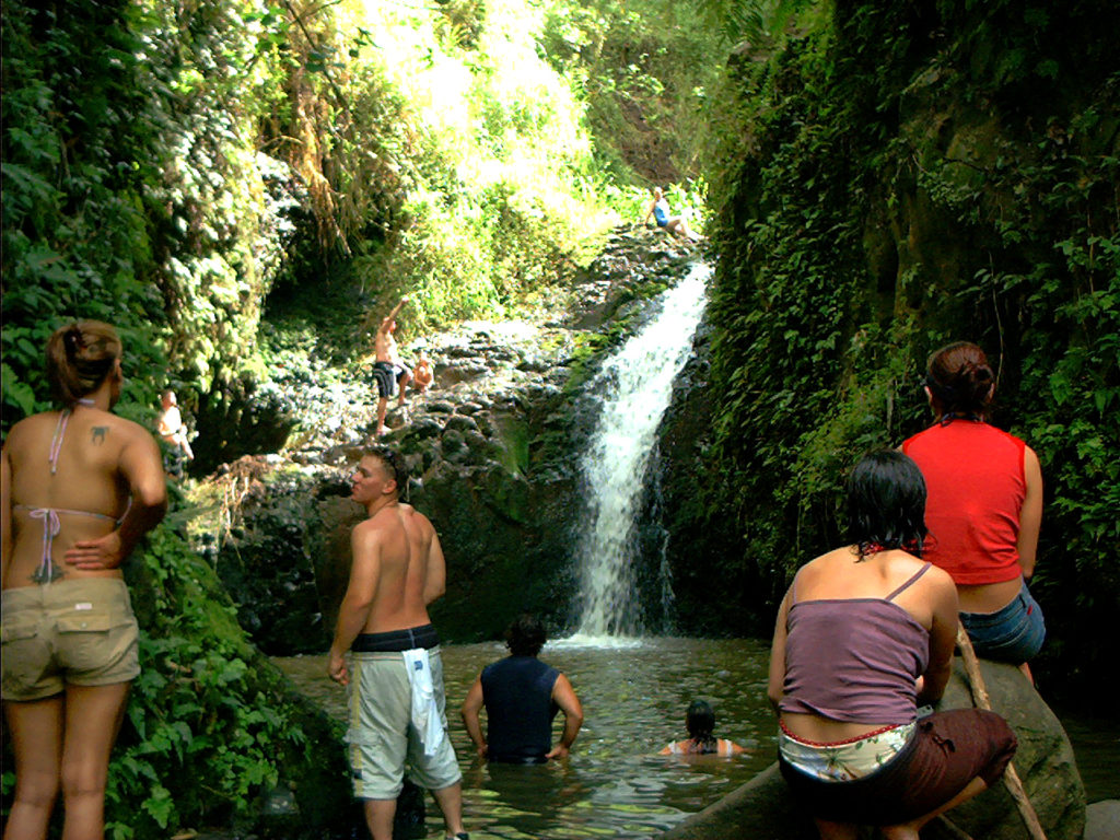 Group of people at waterfall Hawaii
